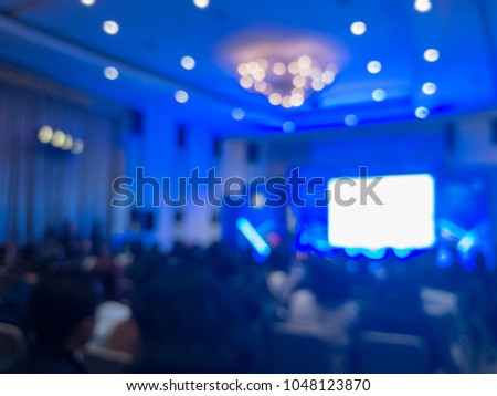 abstract blur of the press conference hall, blurry blue light