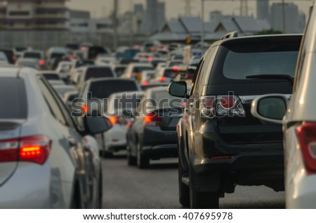 abstract blur of traffic jam with row of cars on expressway during rush hour #407695978