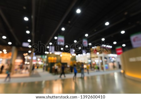 Abstract blur people in exhibition hall event trade show expo background. Large international exhibition, convention center, MICE industry business concept Сток-фото ©