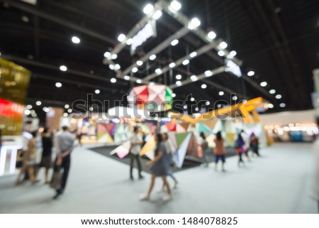 Abstract blur people in exhibition hall event trade show expo background. Large international exhibition, convention center, MICE industry concept