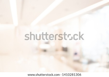 Abstract blur shopping mall corridor. Blurred retail and hall interior in department store. Defocused bokeh effect background or backdrop for business concept. #1410281306