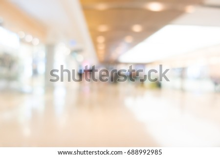 Abstract blur shopping mall in department and retail store interior for background #688992985