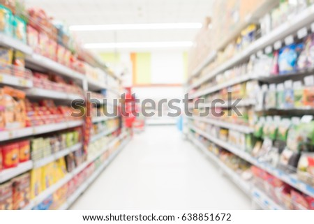 Abstract blur shopping mall in supermarket and department store interior for background