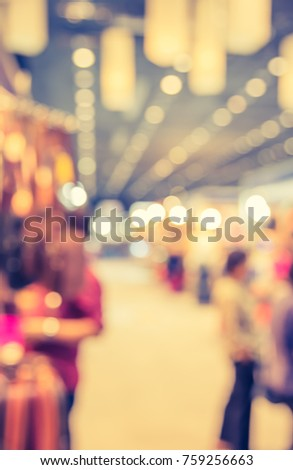 Abstract blur Shopping mall or Exhibition hall with bokeh for background usage . (vintage tone) #759256663
