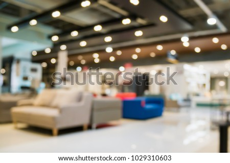 Abstract blur sofa in home decor furniture showroom store interior with bokeh light background for montage product display