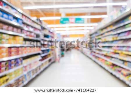 Abstract blur supermarket shopping in derpartment store interior for background