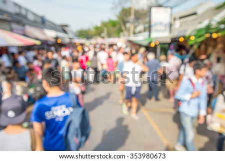 Abstract blur tourist shopping in Chatuchak weekend market outdoor in sunny day Bangkok Thailand background #353980673