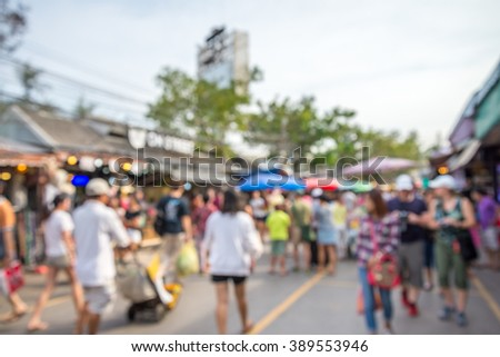 Abstract blur tourist shopping in Chatuchak weekend market outdoor in sunny day Bangkok Thailand background #389553946