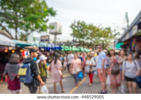 Abstract blur tourist shopping in Chatuchak weekend market outdoor in sunny day Bangkok Thailand background #448529005