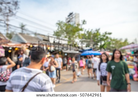 Abstract blur tourist shopping in Chatuchak weekend market outdoor in sunny day Bangkok Thailand background #507642961