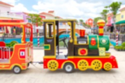 Abstract blurcarnival train at amusement park