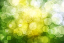 Abstract blurly white bokeh on yellow and green background