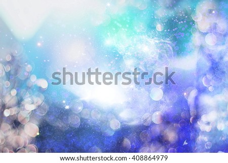 abstract blurred and silver glittering shine bulbs lights background:blur of Christmas wallpaper decorations concept.holiday festival backdrop:sparkle circle lit celebrations display