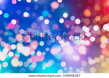 Stock Photo abstract blurred and silver glittering shine bulbs lights background:blur of Christmas wallpaper decorations concept.holiday festival backdrop:sparkle circle lit celebrations display.