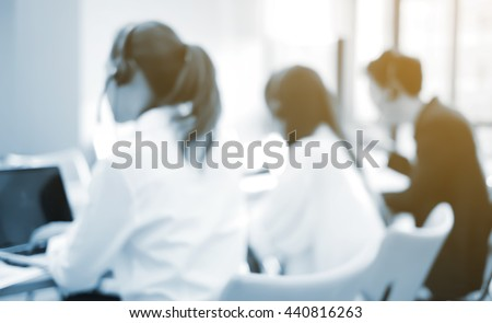 abstract blurred asian employee work in operation office room