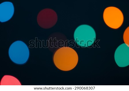 Abstract blurred background and theme: colorful bokeh blurred lights on a dark background