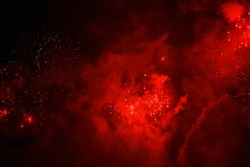 abstract blurred background. celebration. new Year. salute. sparks from fireworks on a background of red haze. looks like a universe