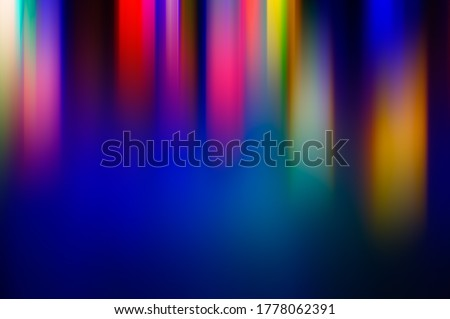 Photo of  Abstract blurred background multicolored light rays elongated vertically. Background for design.