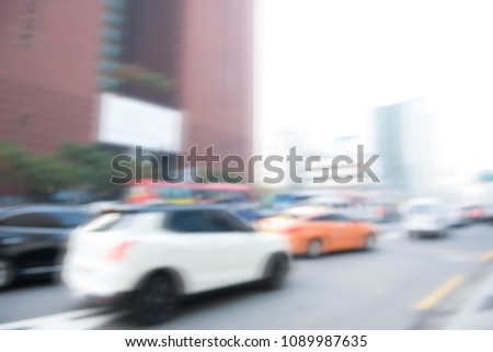 Abstract blurred background of car driving on the road, street view in the city, transportation, traffic background #1089987635