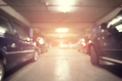 Abstract blurred background of car in parking lot with perspective view