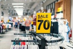 Abstract blurred background of Department store with sale. Store discount sign. Sale sign. Sale concept. Shopping sales sign with percentage discount on price tag