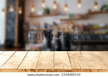 Abstract blurred background of empty wooden table and blurred coffee shop background, product display. Foto stock ©