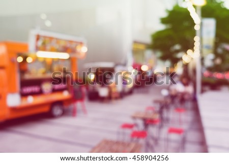 Abstract blurred background of food trucks.