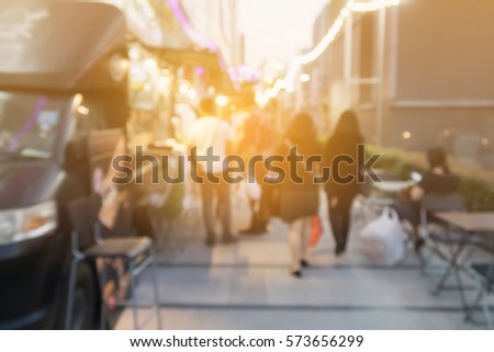 Abstract blurred background of food trucks carnival. #573656299