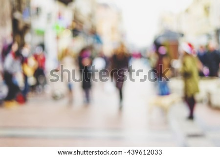 abstract blurred background of people walking in city center #439612033