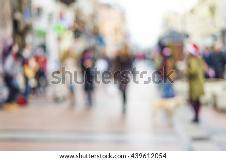 abstract blurred background of people walking in city center #439612054