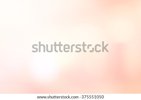 abstract blurred beautiful soft brightening pink background:blur old rose colorful backdrop with bokeh lucent light:beauty shiny wallpaper with lens flare light effect filter:vivid vintage tone image.