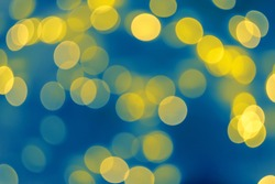 Abstract blurred blue shiny background. Bright confetti glitter. Festive blue and golden luminous background.