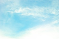 abstract blurred blue sky heaven clouds background with flare lights in cool pastel color cool tone.