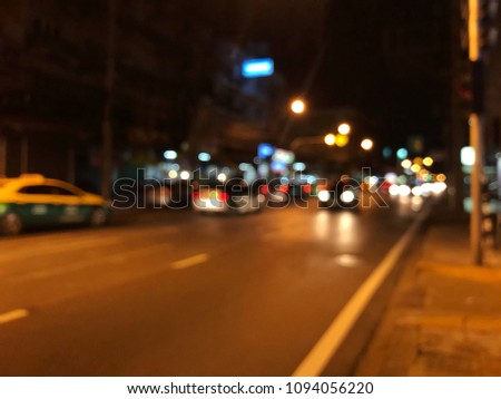 Abstract blurred bokeh image of traffic jam on urban street. #1094056220