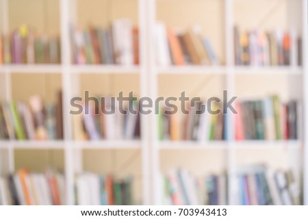 Abstract blurred bookshelves with books, manuals and textbooks on bookshelves in library or in book store, for backdrop. Concept for education