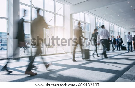 Abstract blurred Business people walking in the office corridor #606132197