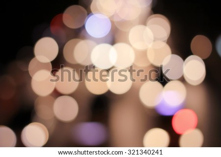 Abstract blurred colorful of traffic circle light backgrounds : blurred night city with color bokeh light :blurred backdrop concept:blur background in vintage tone colored :out of focused concept