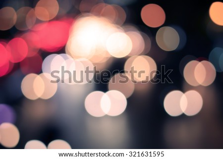 Abstract blurred colorful of traffic circle light backgrounds:blurred night city with colour bokeh light :blur circle light christmas festive backdrop concept:blur background in vintage tone colored.