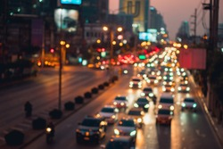 Abstract blurred congestion traffic at night on Rama IV road in Bangkok, Thailand