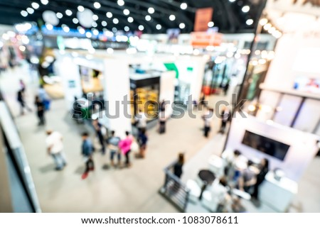 Abstract blurred defocused trade event exhibition background, business convention show concept. Top view.