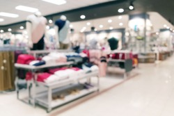 Abstract blurred department clothing store interior background. Blur aisle of supermarket or warehouse for backdrop and design element use. Defocused background with bokeh light.