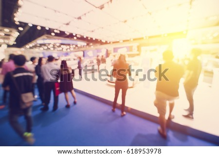 abstract blurred event with people for background #618953978