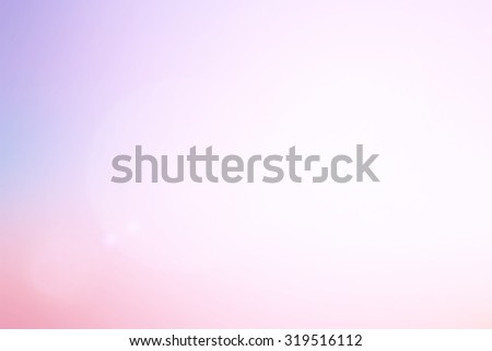 abstract blurred glamour blush color background with shiny flare light for design concept.