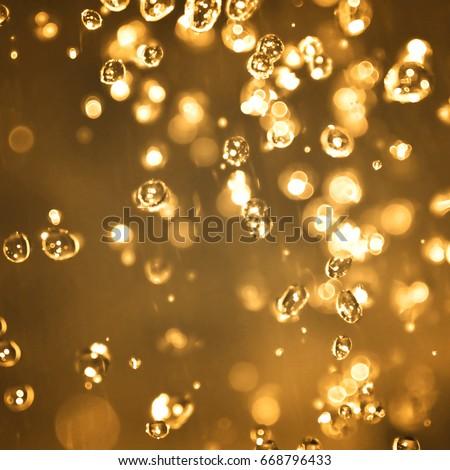 abstract blurred golden rain drops bokeh light background #668796433