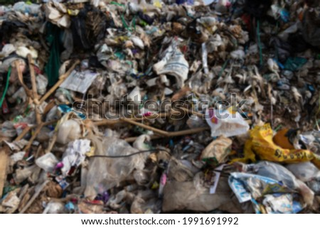 Abstract blurred image. Large Waste plastic bottle pile at Garbage pit landfill sites. A lot of Garbage for recycle management.