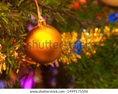 Abstract blurred image of a Christmas tree decorated with glitter, lights and glass balls for the Christmas and New Year celebrations #1499175506