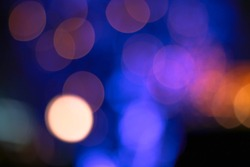 Abstract blurred image of Carnival amusement part background.