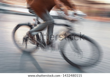 Abstract blurred image of cyclist on the city roadway. Intentional motion blur #1432480115