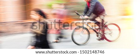 Abstract blurred image of cyclist on the city roadway. Intentional motion blur #1502148746