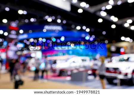 Abstract blurred image of exhibition show. Blur background of international motorshow, Bangkok , Thailand. car show room. Abstract blurred image of people in big events, international cars show.